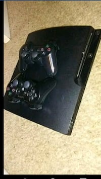black Sony PS3 slim console with two controllers Macon, 31210