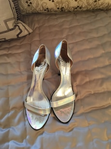 women's pair of gray leather heeled sandals