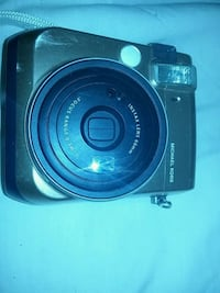 black Canon point-and-shoot camera 1963 km