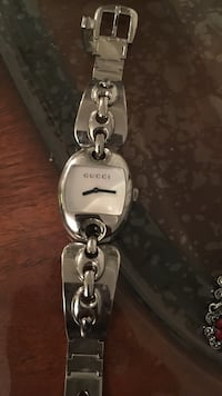 silver-colored Gucci analog watch with linked bracelet