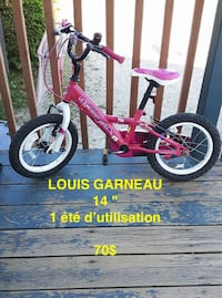 toddler's pink and white bicycle Sherbrooke