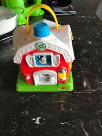 white and red LeapFrog barn plastic toy