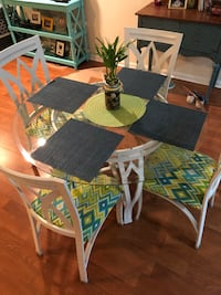 45 inch round glass top table with 4 chairs. Newly upholstered. Indoor/ outdoor stain treated fabric. Iron set with protective feet. Cash only. Lake Worth, 33463