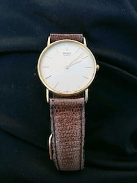round silver-colored analog watch with brown leather strap Johnson City, 37601