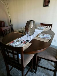 rectangular brown wooden table with six chairs din Las Vegas, 89119