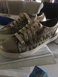 brown-and-white Michael Kors low-top sneakers Charlotte Hall, 20622