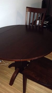 Round brown wooden dining table De Witt, 13214