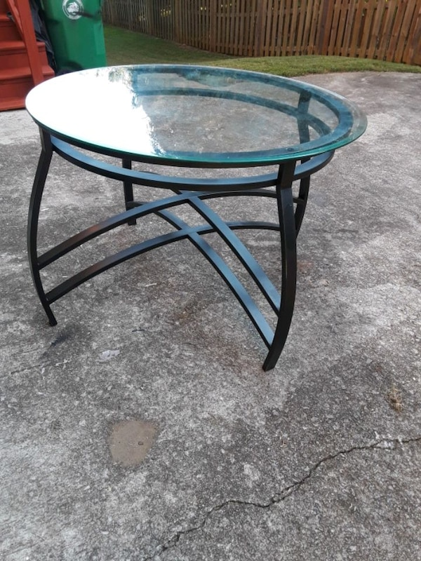 Round Glass Top Dining Table  065941c9-ccce-4d7f-8c3d-e55b535dd8e1