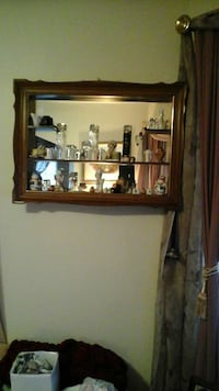 Wall shelf mirror. Items on shelves are not