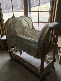 Wooden bassinet from Eddie Bauer has a music and gently racking If you turn on a switch. Harpers Ferry, 25425