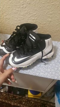 pair of black-and-white Nike cleats Denver, 80204