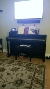 black flat screen TV; black wooden TV stand Augusta, 30907