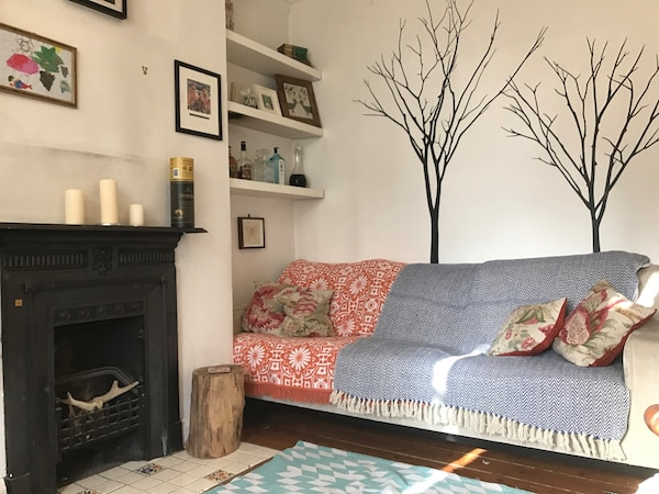 Wide three seater sofa with throws and cushions