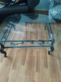 black and brown wooden framed glass top coffee table Deltona, 32738