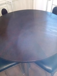 round brown wooden table with four chairs dining set Caledon, L7E 2Y5