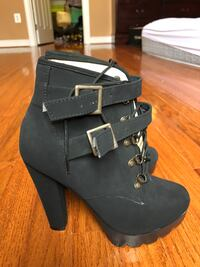 Pair of women's black suede chunky heeled buckled booties Boyds, 20841
