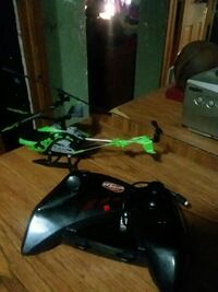 green and black helicopter with controller Chenoa, 61726