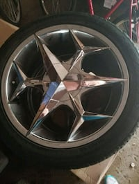 chrome 5-spoke car wheel with tire Milwaukee