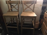 Two brown Bistro Bar stools. The pair for $250.00 Crafted with Distress Hardwood, Phoenix, 85041