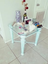 white and pink wooden base glass top table