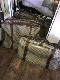 Two Gucci luggage