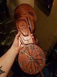 Native carving with clock Duncan