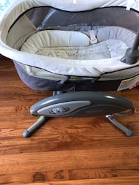 baby's gray and white bouncer 2 km