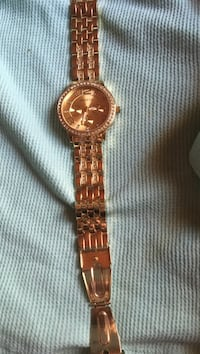 Gold Geneva watch with diamonds on both sides and face. Clasp broken