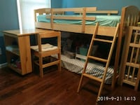 Bunk bed with desk, chair and mattress.