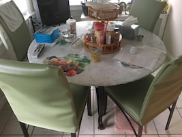 Bronze table and 4 chairs with glass table great condition. Slip covers not included. Must sell leaving the city.