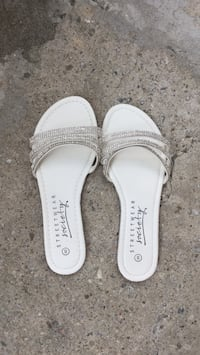 pair of white leather sandals Toronto, M1W 2R7