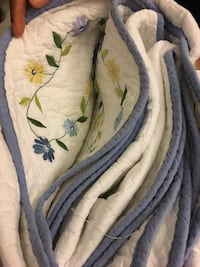 white and blue floral textile 24 mi