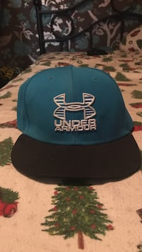 blue, white, and black Under Armour embroidered snapback