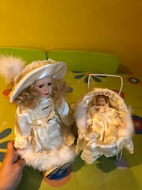 two porcelain doll wearing white dress Laval, H7T 2R9