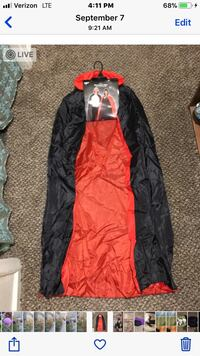 Reversible adult size cape. Brand new. In pkging  Idaho Falls, 83402