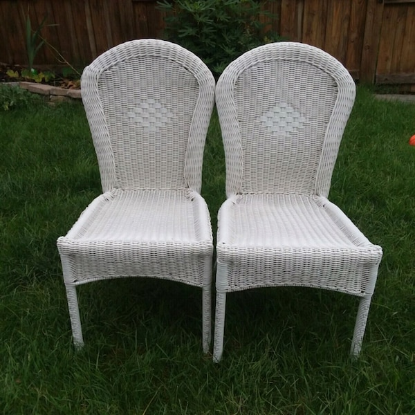 A Pair of Resin White Chairs