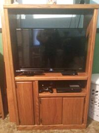 flat screen television with brown wooden TV hutch Anderson, 46011