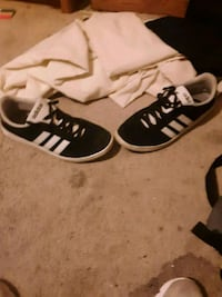 pair of black-and-white Adidas sneakers 424 mi