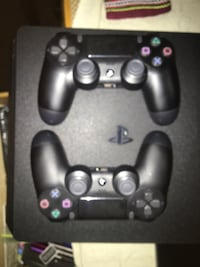 black Sony PS4 game console with two controllers Edmonton, T6E 1E5