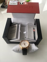 round gold-colored chronograph watch with black leather strap 3750 km
