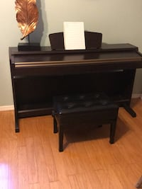 piano with bench and music Pinellas Park, 33702