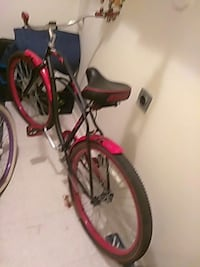 red and black beach cruiser bike. West Valley City, 84119