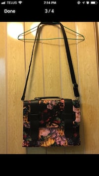 Black and pink floral leather crossbody bag screenshot