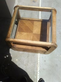 brown wooden framed glass top table Merced