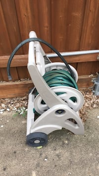white and green clothes iron