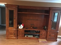 Brown wood entertainment center  North Vancouver