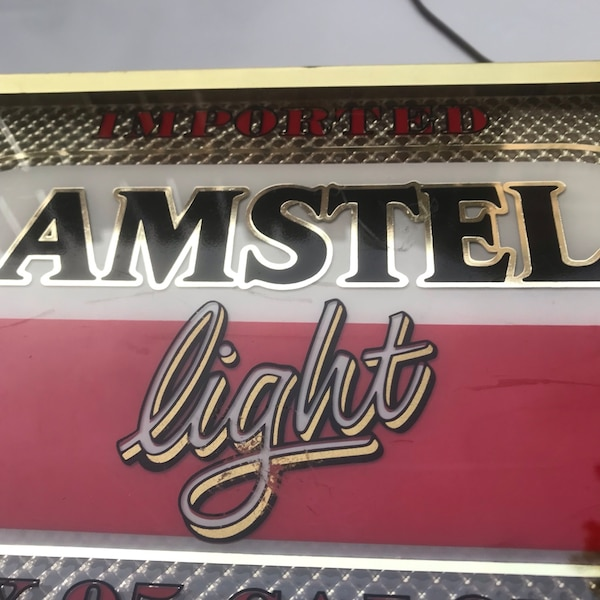 vintage Amstel Light Up sign b09dbf97-ab29-4edf-bd09-ec17f1e13996