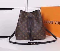 brown and black Louis Vuitton leather hobo bag