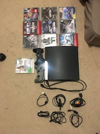 Black sony ps3 slim console with controller and game cases Edmonton, T6X 0M3