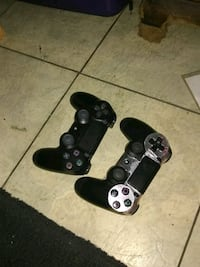 two black Sony PS4 controllers Hudson, 34667